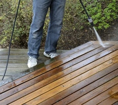 Deck Surface Being Cleaned With Pressure Washer