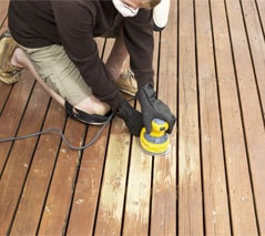 deck surface being sanded