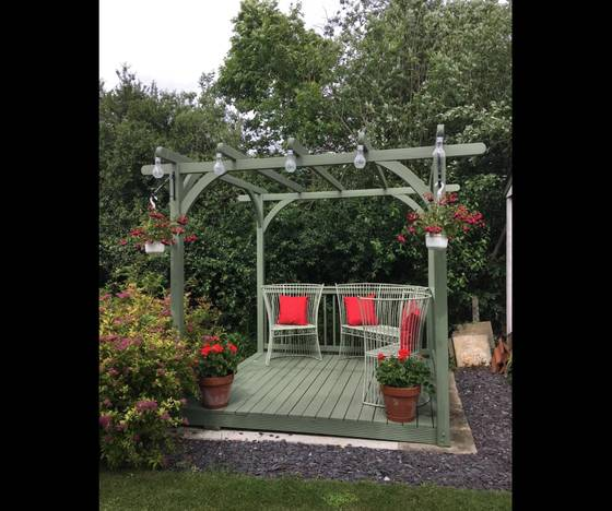firmtread green painted deck with pergola